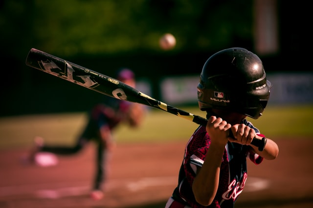 Young boy playing baseball beginner player