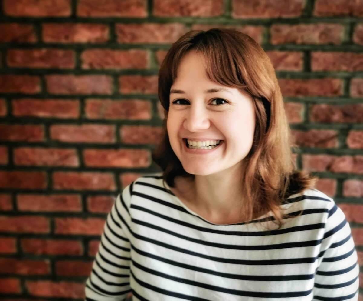 A smiling woman developer